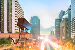 CCTV Security Camera or surveillance Operating on traffic road i. N sunset Stock Photos