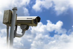 CCTV security camera under blue sky Stock Image