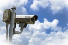 CCTV security camera under blue sky Stock Image