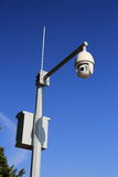Security surveillance camera. Electronic cctv security surveillance camera on top of pole royalty free stock photo