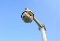 Security surveillance camera. Electronic cctv security camera, surveillance camera on top of pole on blue sky background royalty free stock photo