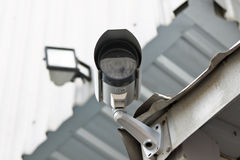 CCTV security camera at the wall Royalty Free Stock Photography