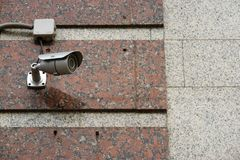 CCTV security camera on the wall outside. CCTV security camera on the wall outside stock photos