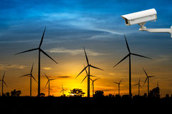 CCTV security camera with Wind turbine power generator with suns Stock Photos