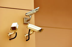 Cctv security cameras. Three cctv security cameras on the wall royalty free stock photos