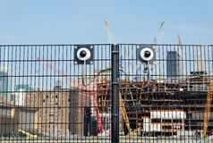 Cctv security cameras on a fence. Around construction site in New York city, New York, USA Royalty Free Stock Images