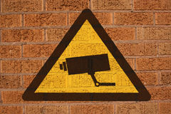 CCTV sign on brick wall Royalty Free Stock Photos