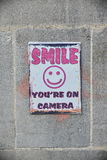 CCTV Smiley Face Sign. View of a Generic CCTV Smiley Face Sign with the Text `Smile You`re on Camera Royalty Free Stock Images