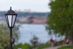 CCTV surveillance camera mounted on vintage street lantern Stock Images