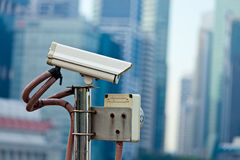 CCTV surveillance camera in Singapore. With skyscapers in background Royalty Free Stock Photos