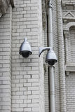 CCTV or surveillance operating on the outer brick wall of the Naval Cathedral of St. Nicholas, Kronstadt. royalty free stock image