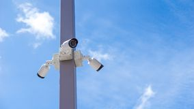 CCTV surveillance security camera video equipment on pole outdoor location safety system area control and copy space royalty free stock photo