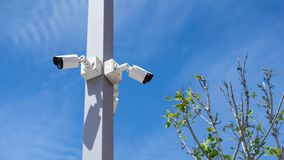 CCTV surveillance security camera video equipment on pole outdoor location safety system area control and copy space royalty free stock photography