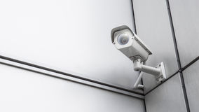 CCTV surveillance security camera video equipment in tower home and house building on wall for safety system area control outdoor. Security camera and building royalty free stock photo
