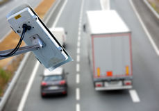 CCTV system on the road. Security CCTV camera or surveillance system with road highway on blurry background Stock Photography