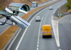CCTV system on the road. Security CCTV camera or surveillance system with road highway on blurry background Royalty Free Stock Images