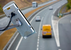 CCTV system on the road. Security CCTV camera or surveillance system with road highway on blurry background Royalty Free Stock Photography