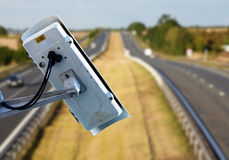 CCTV system on the road. Security CCTV camera or surveillance system with road highway on blurry background Royalty Free Stock Photos