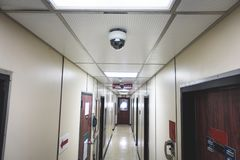 CCTV system security camera or cctv camera on ceiling in apartment room or living quarter royalty free stock images