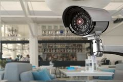 CCTV system security inside of restaurant with people eating blur background. Surveillance privacy video technology abstract protection crime safety interior stock photos