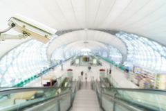 CCTV system security monitoring in airport. Blur background stock photo