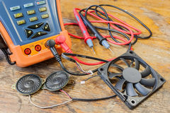 CCTV tester with probes, CPU fan and loudspeakers on a table in a workshop Royalty Free Stock Images