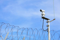 CCTV on top of chain link Stock Photo