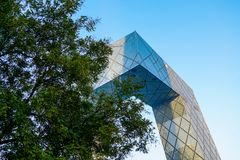 The CCTV Tower of Beijing, China. CCTV Headquarters during blue day in Beijing. The CCTV building is a loop of six horizontal and vertical sections with a total royalty free stock image