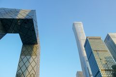 The CCTV Tower and CITIC tower of Beijing, China, during blue day in Beijing. The CCTV building is a loop of six horizontal and vertical sections with a total stock photo