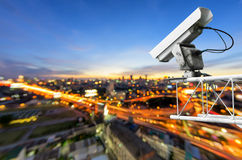 CCTV with traffic. CCTV cameras, security cameras. With the backdrop tail lights blurred on the road from a high angle royalty free stock images