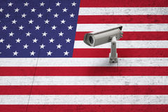 Cctv with usa flag on textured wall background Royalty Free Stock Photo