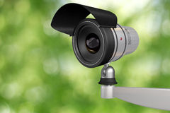 Cctv video camera. Security system in green background Stock Images