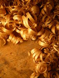 CCurly Wood Shavings. Cedar wood shavings created by an antique plane Royalty Free Stock Photos