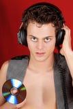 CD的光盘耳机骑师 免版税图库摄影