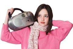 CD的女孩藏品听的音乐可移植的俏丽的收音机 库存照片