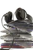 CD的收集耳机 免版税图库摄影
