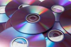 Cd的,在白色背景隔绝的dvd的 库存图片