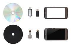 CD, USB闪光驱动,流动在白色隔绝了背景 免版税库存图片