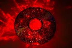 CD λαμβάνοντας υπόψη το κόκκινο λέιζερ Στοκ Φωτογραφίες