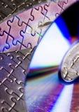 CD και κομμάτια γρίφων Στοκ Φωτογραφία