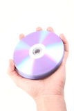 CD. Hand with CD isolated on white, no dust Royalty Free Stock Images