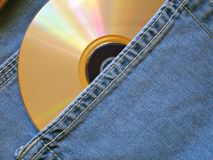 CD. Raibow compact disc within pocket stock photography