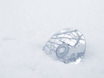Cd 2. Cd-disk in the snow royalty free stock images
