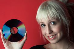 Cd. Attractive blond girl hold cd Stock Photography