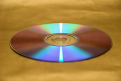 CD. Compact disc on gold background Stock Photo