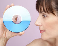 CD. Model with cd in hands in front of face Stock Photo