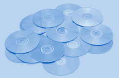 CD Background. A bright blue heap of CD / DVD media Stock Images