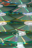 Cd background vertical. Cd's stacked up with a blue/green color cast Royalty Free Stock Images