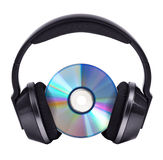 CD in black wireless stereo headphones Stock Image