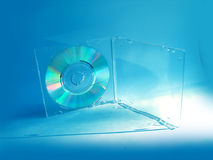 CD in blue tones. CD in box, on light blue background royalty free stock images